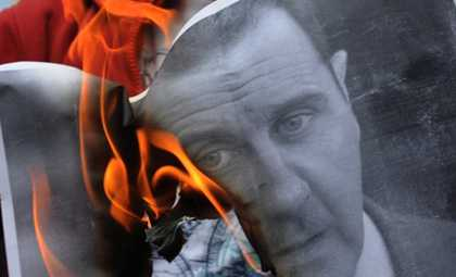 A protester burns a picture of President Bashar al-Assad in Istanbul. According to one Syrian activist, fear is slowly dying as similar scenes are being witnessed inside Syria. (AFP/Bulent Kilic)