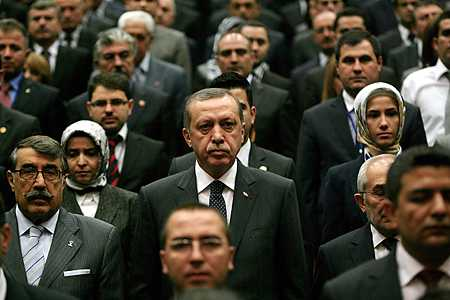 Turkey's Prime Minister Tayyip Erdogan stands among Justice and Development Party (AKP) members during a meeting at the party headquarters in Ankara, September 28, 2011. (Photo: Adem Altan /AFP / Getty Images)  Read more: http://globalspin.blogs.time.com/2011/09/29/turkish-p-m-erdogan-we-cannot-deny-our-ottoman-past/#ixzz1ZReBaTZ0
