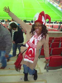 PHOTO COURTESY OF JOI HOLLIES  Joi Hollies gets excited for her new local team at a football match between Turkey and Azerbijan for the EuroCup qualifier. Turkey won the game.