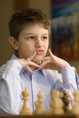 Aydin Turgut takes a moment to think before making his next move. (Herald & Review/Lisa Morrison)