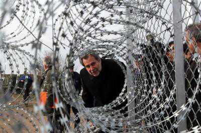 Greek Civil Protection Minister Christos Papoutsis checks part... ((AP Photo/Nikolas Giakoumidis))