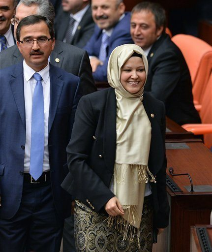 Nurcan Dalbudaki, one of four ruling Justice and Development Party lawmakers wearing headscarves, who walked into Turkey's parliament, arrives with other lawmakers in Ankara Thursday, Oct. 31, 2013, marking the end of a longstanding ban in the chamber. The female members of parliament had announced their intentions after restrictions that were imposed in the early days of the Turkish Republic were recently lifted. The issue is highly charged in a country founded in 1923 under strict secular principles. AP PHOTO Read more here: http://www.islandpacket.com/2013/10/31/2765986/turkish-mps-enter-parliament-with.html#storylink=cpy