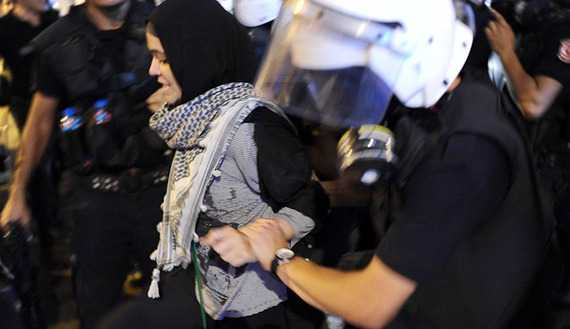 Police arrest a demonstrator during clashes in Istanbul, Sept. 10, 2013. (photo by BULENT KILIC/AFP/Getty Images) Read more: http://www.al-monitor.com/pulse/originals/2013/11/headscarf-turkey-history-parliament-protest.html#ixzz2k60dRa3S