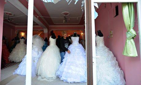 Wedding gowns in a shop window in Reyhanli